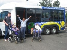 mellor bus with people in wheelchairs outside