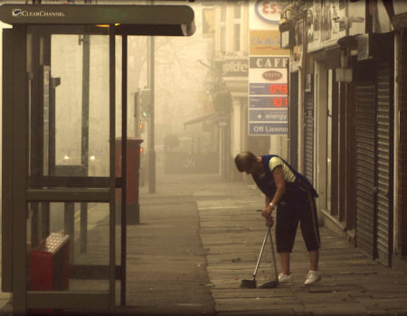 empty bus stop with cleaner